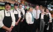 Dorothy Lane Market newest location located on 741 in Springboro, Ohio. Norman Mayne (4th from the right), president and chief executive officer of Dorothy Lane Market, poses with a group of employees.