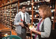 FILE PHOTO: Dorothy Lane Market newest location located on 741 in Springboro, Ohio. Giri Dodballapur, beer and wine manager, discusses a wine selection with customer Christi Grossman of Springboro.
