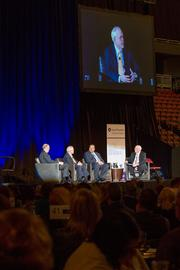 Sedgwick County Commision Chairman Dave Unruh speaks on the importance of Wichita aggressively working to attract jobs during the Wichita Metro Chamber of Commerce 2014 Chairman's Lunch, Thursday afternoon at Intrust Bank Arena.