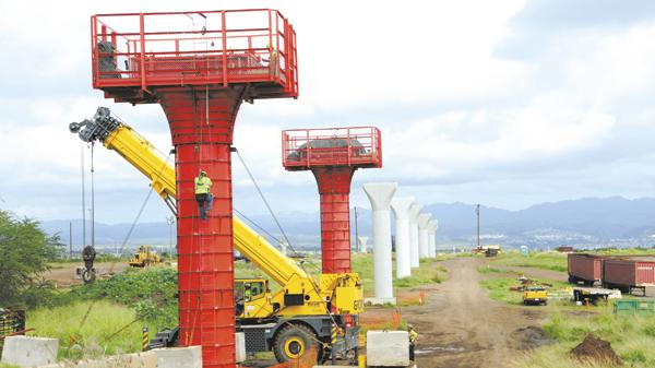 Kiewit workers are seen in this file photo with the first 47 of an eventual 422 rail columns for the Honolulu rail project. The Honolulu Authority for Rapid Transportation is holding a forum on May 5 for local businesses who want to bid on contracts for the construction of the $5.16 billion project.