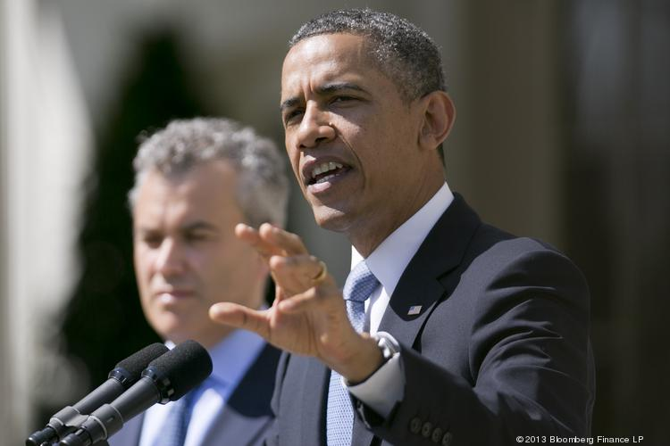 U.S. President Barack Obama, right, speaks in the Rose Garden of the White House with Jeffrey Zients, acting director of the Office of Management and Budget (OMB), left, in Washington, D.C., U.S., on Wednesday. Obama sent a $3.77 trillion spending plan to Congress today that calls for reductions in Social Security and Medicare in a political gamble intended to revive deficit-reduction talks.