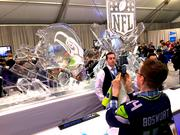 A Super Bowl calls for a super ice sculpture. (Not sure why this guy is wearing a Brian Bosworth jersey in public.)