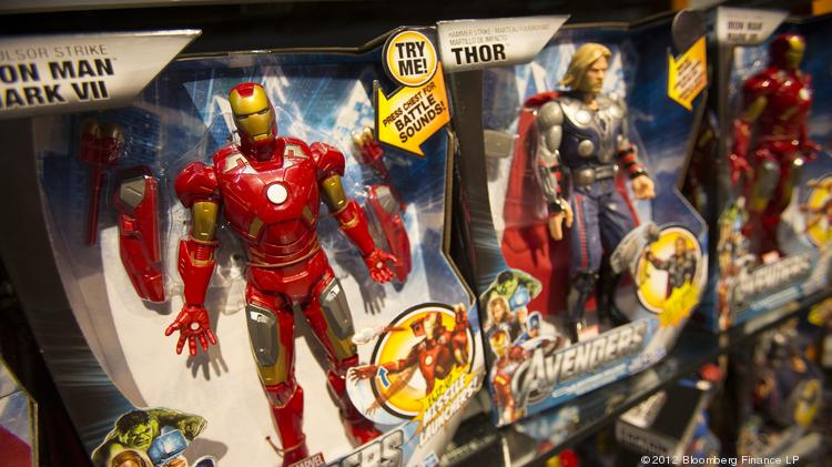 "Hasbro Inc. toys from based on ""Marvel's The Avengers"" movie sit on the shelf at a Toys ""R"" Us Inc. store in New York. Hasbro is among the companies expected to release earnings on Monday."
