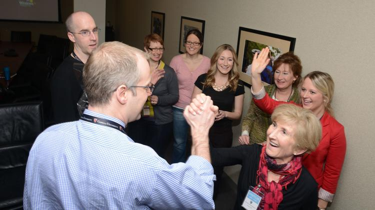 Mike Buttry of Capella Education Co. high fives Margie Sborov, Founder of the Angel Foundation who wrote one of his nomination letters, upon hearing that he was selected for the 40 Under 40.