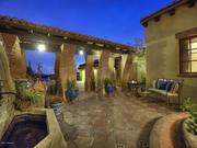 The Hacienda-style estate offers several patios.