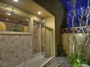The master bath's indoor shower leads to a private outdoor shower on another patio.