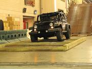 A Jeep Wrangler on the indoor obstacle course.