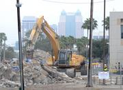The downtown Orlando skyline seems to watch over the progress.