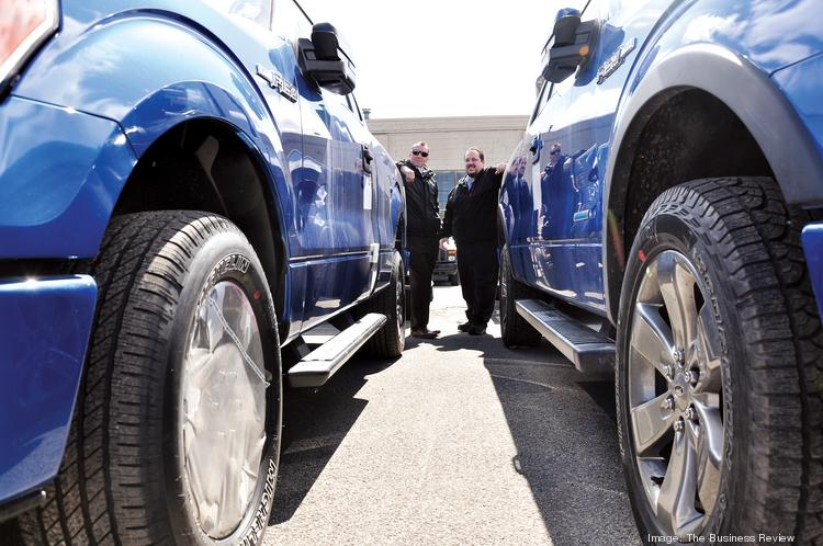 Ford saw sales of its popular F-Series pickup increase 16 percent last month to 67,513. Here, Justin Matuszek, a sales rep at Orange Motors, and Richard Bell, commercial account manager, show off the latest models.