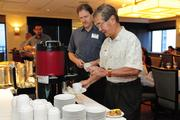 Attendees get coffee prior to PBN's panel discussion on health care reform at the Plaza Club in Downtown Honolulu on Friday.