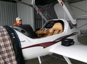 Flight instructor Christine Mortine does a pre-flight check of the plane at Delaware Municipal Airport.