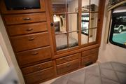 Jayco's Precept Motorhome's master bedroom features lots of cabinetry.
