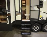 This camper has a bathroom that is accessible from the exterior.