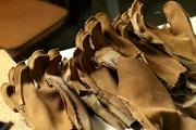 Partially finished gloves for the military wait to have the next pieced sewn on at Outdoor Research in Sodo.
