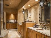 Custom woodwork is featured throughout the home, including in the master bath.