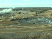 Duke Energy has employed cranes and earth-moving equipment at the Dan River Steam Station to dig down to a broken pipe underneath a 27-acre ash pond that has spilled pollutants into the river.