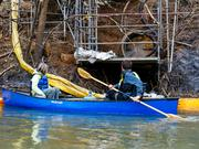 Waterkeeper volunteers at the sealed pipe where up to 39,000 tons of coal ash spilled from the shuttered Dan River Steam Station into the river.