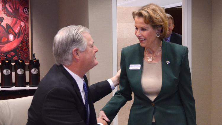 Sandy Shugart of Valencia College greets Ann McGee of Seminole State College as she arrives at Orlando Business Journal's education industry outlook. Valencia is planning a new building on its West Campus.