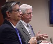 From left: Paul Jarley and Dan Holsenbeck represent UCF at the education industry update.
