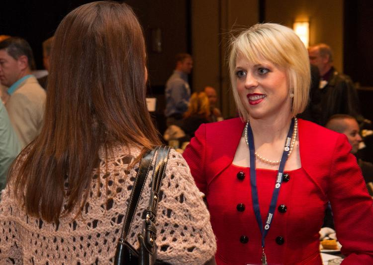 Lindsay Young speaks with a guest at the annual Associated General Contractors state awards Friday afternoon at the Wichita Marriott.