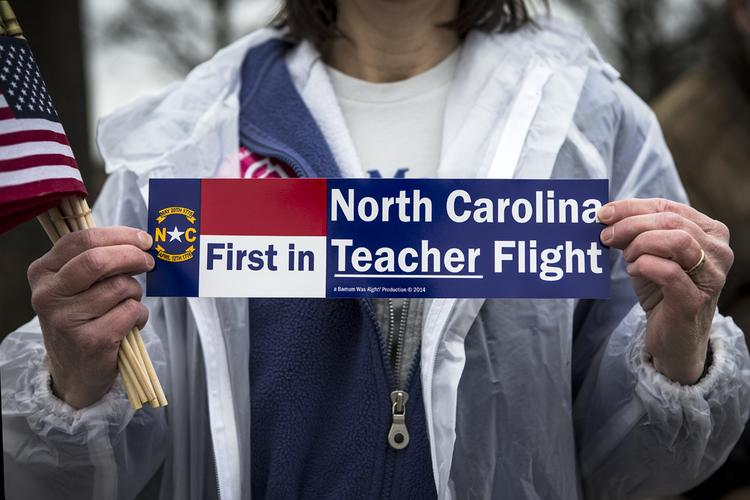 A woman advocates for teachers over the weekend. Gov. McCrory announced a plan to increase teacher pay by 16 percent in two years.