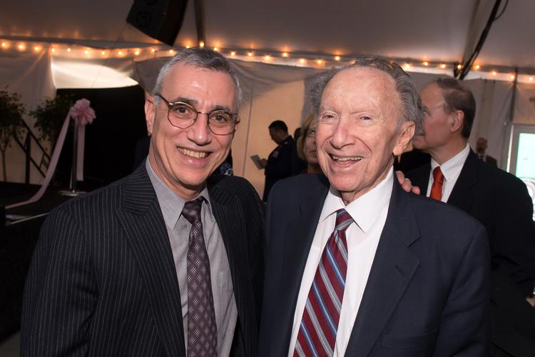 Dr. Tom Scalea, physician-in-chief at the R Adams Cowley Shock Trauma Center, left, with Willard Hackerman at an event in November 2013. Hackerman was a major supporter of local health care projects.