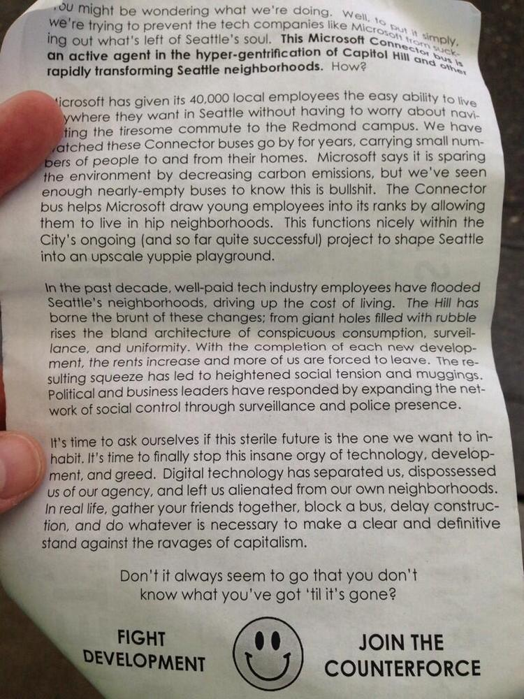 A flier handed out by protesters Monday morning blames Microsoft for the gentrification of Seattle's Capitol Hill neighborhood.