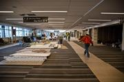 Workers finish construction at RDU's Terminal 1 building in anticipation of the March 2 grand opening.