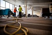 Workers prepare to install more passenger seats in the waiting area of RDU's Terminal 1 building.