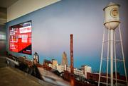 A scene of downtown Durham is captured in an image on a wall inside of the Terminal 1 building at RDU.