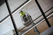 A worker checks ceiling panels at RDU's Terminal 1.