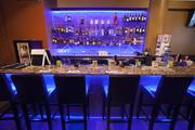 The bar area has blue, purple, and teal accent lights.