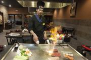 In addition to preparing food in front of diners, chef Damon Yang puts on a show.