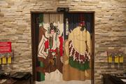 Doorways are adorned with drapes with a Japanese theme.