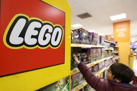 A boy selects a boxed Lego A/S toy at an E-Mart Co. store, a subsidiary of Shinsegae Co., in Incheon, South Korea, in December.