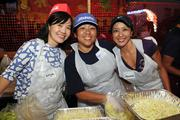 From left, Mayumi Hara Dao of John Hara Associates, Vanessa Kau of the Whitby Co. and Jeannie Camacho of the Honolulu District office, all 1991 alumni, prepping vegetables at the noodle booth at the Punahou Carnival.