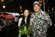 Punahou School President James Scott, with  daughter Tessa, working in the plant booth at the Punahou Carnival.