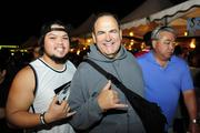 Hawaii comedian Frank Delima with Makamae Wengler, assistant to Frank Delima, supporting the Punahou Carnival.