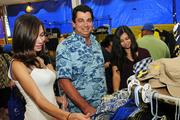 Mike Hiu, center, health and safety supervisor for Environmental Chemical Corp., 1986 alumnus, with daughters Shawna, left, and Katherine, in the Alumni Asociation booth at the Punahou Carnival.
