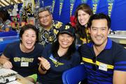From left, Kristin Izumi-Nitao, executive director of the campaign spending commission and a 1984 Punahou alumna; Rich Asato, partner at Imanaka Asato, and 1982 Punahou alumnus, Wendy Zane Pang, executive vice president of Honolulu Homeloans, and 1988 Punahou alumna; Leeanne Jim-Phillips, consultant and 1987 Alumna, and Bryan Luke, president of Hawaii National Bank and 1993 alumnus, volunteering at the Punahou Alumni Association booth at the Punahou Carnival.