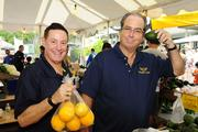 Steve Sofos, left, president of Honolulu-based Sofos Realty Corp., and 1971 alumnus, and Mike Carr, president of the USS Missouri Memorial Association, volunteering at at the O-Men fresh produce booth.