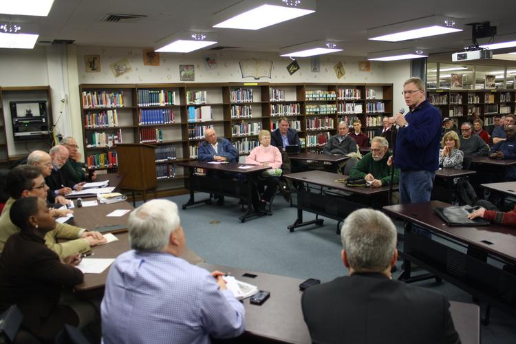 Tom Van Hoozer addresses the Mayor's KCI Advisory Board at the group's first town hall held at Oak Park High School on Monday. Van Hoozer told the group he thinks citizens shouldn't be treated as an afterthought in their decision.
