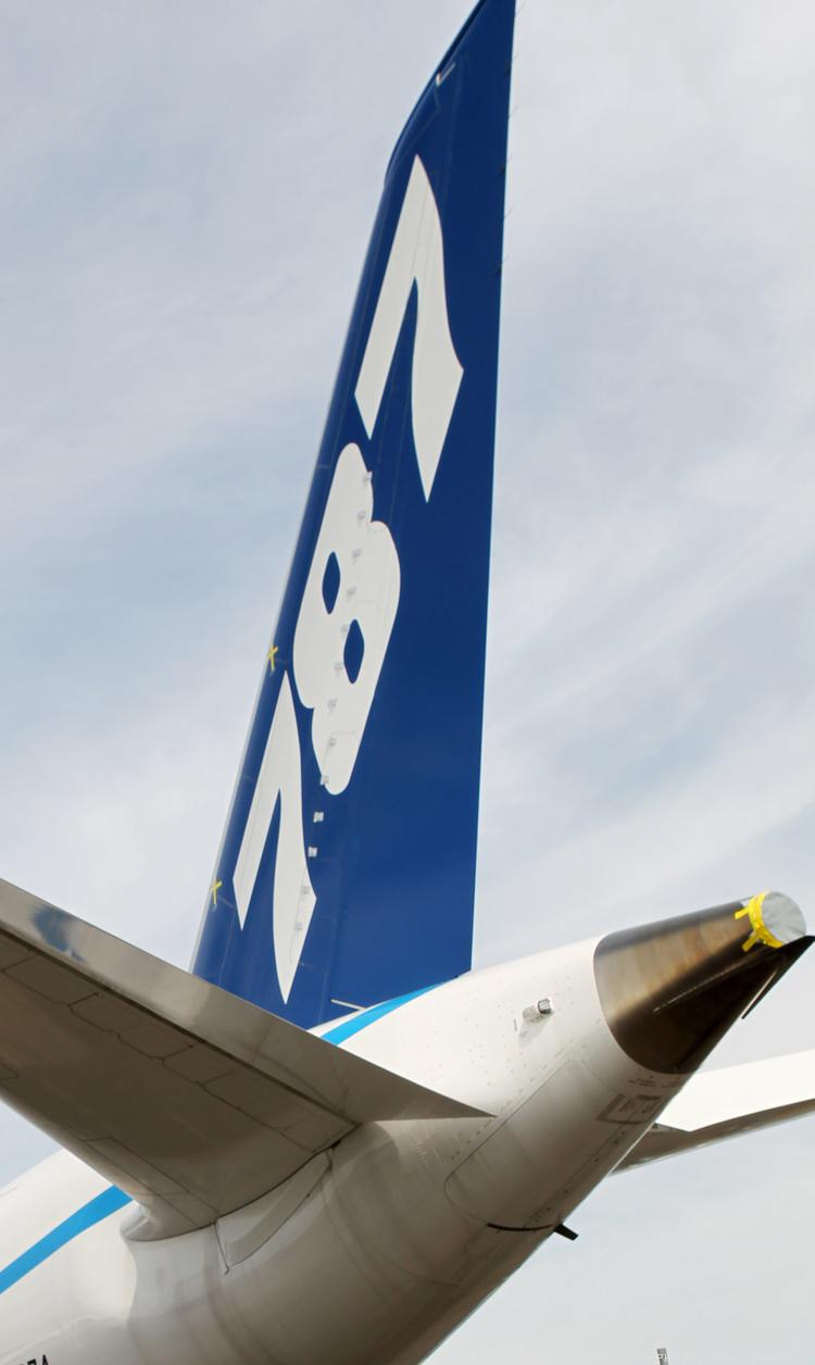 The tail section of a Boeing 787 Dreamliner that sits on the parked at Boeing Field as seen on June 21, 2012.