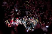Russ Smith carried the NCAA championship trophy into the arena as he was introduced.
