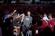 Tim Henderson slapped hands with fans as he was introduced Wednesday.