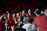 Peyton Siva also carried the trophy as he entered the arena.