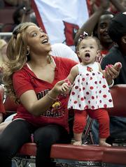 One-year-old Jazelle Smelling and her mom, Shana Smelling, cheered the players.