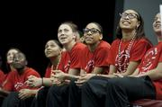 Members of the women's team watched highlight videos during the celebration.