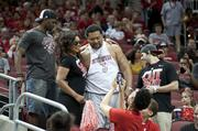 Peyton Siva Sr., father of U of L's senior guard, stopped for a photo with a fan.