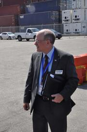 Glenn Wiltshire, deputy port director, watches the events.